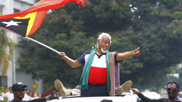 East Timorese independence hero Xanana Gusmao waves a national flag upon arrival in Dili in March.