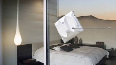 Interior of modern bedroom tethered to its safety pod, which attaches to the window with a suction cub, the winbot keeps a great grip.