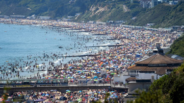 Crowds defied social distancing advice to swamp Bournemouth beach in southern England.