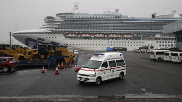 An ambulance leaves the port where the quarantined Diamond Princess cruise ship is docked.