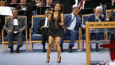 Ariana Grande performs during the funeral service for Aretha Franklin, Bill Clinton is on the right.
