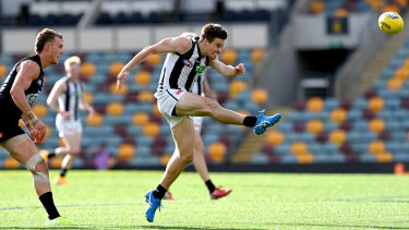 Kicking goals: Josh Thomas boots a major for the Magpies.