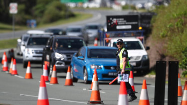 Police checks for border passes continue to cause traffic delays.