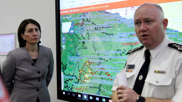 NSW Premier Gladys Berejiklian is briefed by RFS Commissioner Shane Fitzsimmons at the RFS headquarters in Sydney, Monday, January 6, 2020.