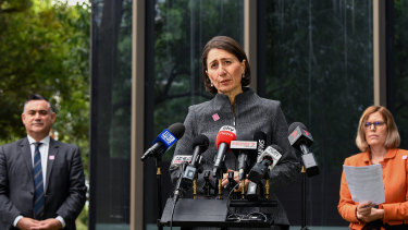 Deputy Premier John Barilaro, Premier Gladys Berejiklian and Chief Health Officer Dr Kerry Chant at a press conference in Sydney on Monday.