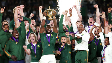 Springboks captain Siya Kolisi hoists the Web Ellis Cup.
