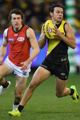 Daniel Rioli gathers the ball.