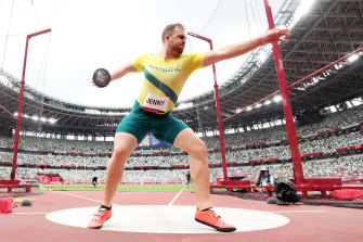 Matt Denny goes about business in the discus qualification at the Tokyo Games.