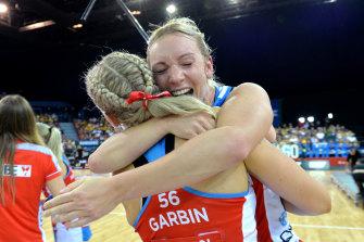 Swifts duo Natalie Haythornthwaite and Sophie Garbin celebrate their Super Netball grand final win.