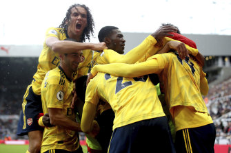 Arsenal players celebrate Pierre-Emerick Aubameyang's goal against Newcastle at St James' Park.