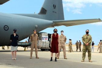 Australian embassy and ADF personnel in front of an ADF C-130 delivery of humanitarian assistance to Lebanon after the Beirut port blast.