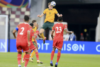 Harry Souttar connects with a header during Australia's win over Oman.