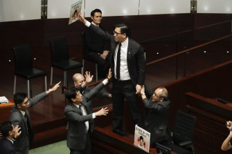 There were extraordinary scenes in Hong Kong's Legislative Council that led to the cancellation of the chief executive's address.