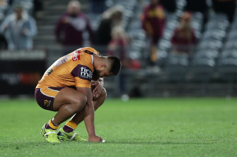 Payne Haas sinks to his knees after the Broncos' sixth straight loss on Saturday night.