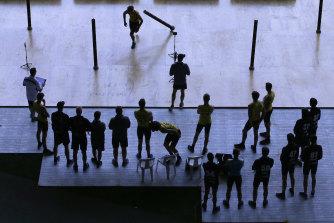 AFL draft hopefuls take part in testing at an AFL draft combine.