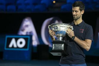 Novak Djokovic with his seventh Australian Open title last year.