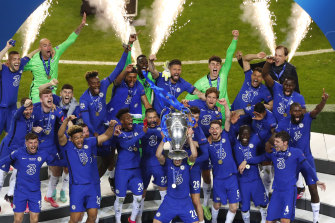 Chelsea players celebrate with the trophy after winning the Champions League final soccer match against Manchester City at the Dragao Stadium in Porto, Portugal.