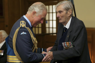 Prince Charles shakes hands with Battle of Britain pilot Paul Farnes in 2017.