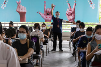 People wait in an observation area at a vaccination hub set up in a Bangkok shopping centre after receiving the AstraZeneca Covid-19 vaccine on Monday.