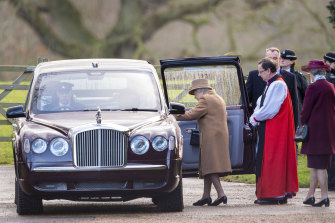Queen Elizabeth II leaves after attending a morning church service at St Mary Magdalene Church in Sandringham, England one day before the meeting.