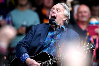 Mike Brady belts out one of his trademark tunes at the MCG.