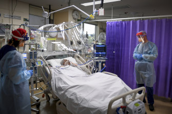 An ICU nurse and an anaesthetist attend to a COVID-infected patient inside the ICU ward of Western Health's Footscray Hospital last year.