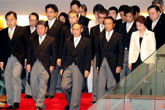 Yoshihide Suga, Japanese Prime Minister, front row centre, with his new cabinet members at his official residence in Tokyo, last week.