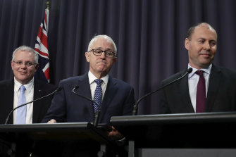 Then Treasurer Scott Morrison watches on as Malcolm Turnbull and Josh Frydenberg address the media on August 20, 2018. Within days, Turnbull would be deposed and Morrison would be PM.