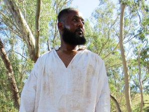 Actor Mohamed Osman playing black African bushranger John Caesar in the documentary.