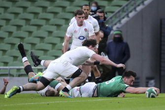 Jack Conan scores a try during Ireland's 32-18 victory over England on Saturday.