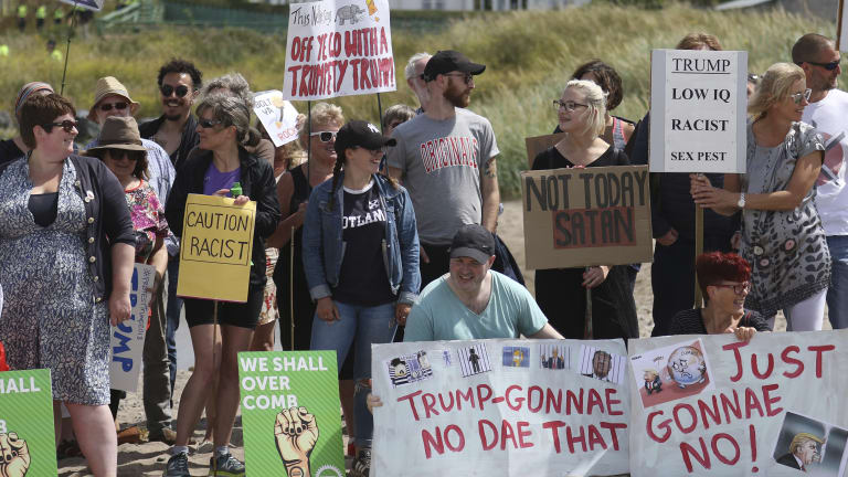 Protesters on a beach near Turnberry golf club, Scotland, on Saturday, July 14.