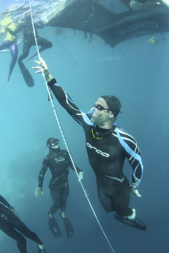 Ant Williams practises for his depth record for diving under the Arctic ice without air or weights.