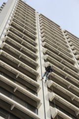 An abseiler tests out the 90 metre Lovett Tower descent.
