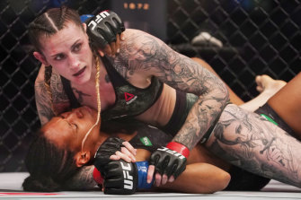 Megan Anderson (top) and Zarah Fairn compete during UFC 243.