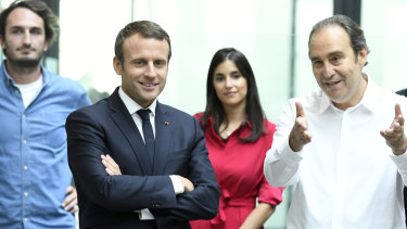 French telecom tycoon Xavier Niel, right, speaks with French President Emmanuel Macron.