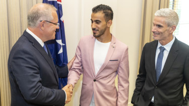 Welcome aboard: Craig Foster looks on as Prime Minister Scott Morrison congratulates Hakeem al-Araibi on his Australian citizenship.