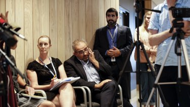 Vascular Surgeon Adib Khanafer, centre, at a media briefing after the Christchurch massacre in March.