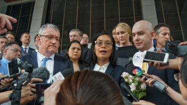 From left, Allan McKinnon, Australian ambassador designate for Thailand, Araibi's lawyer Nadthasiri Bergman and other foreign diplomats address the media after the extradition hearing for Hakeem Al-Araibi on Monday.