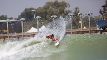 A surfer rides the wave during the first day of a world championship tour at California's Surf Ranch.