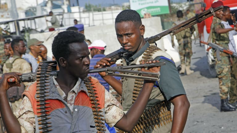 Somali soldiers secure the scene of a car bomb explosion  Mogadishu on Sunday.