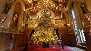 A six-metre-tall-tree being decorated in St George's Hall at Windsor Castle.