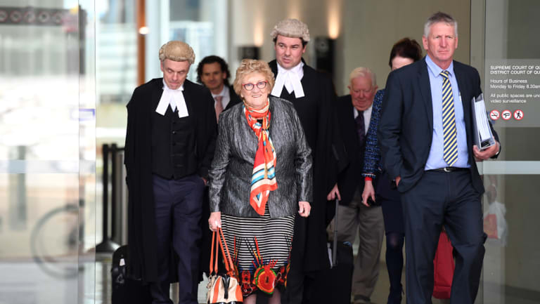 Mary Wagner (centre), her son Denis Wagner (right) and members of the family leave the Supreme Court in Brisbane, Thursday.