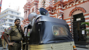 A Sri Lankan police officer announces security warnings outside Colombo's Red Mosque this week.