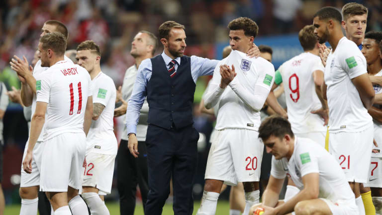 Home soil: Gareth Southgate consoles Dele Alli after England's defeat in this year's semi-finals.