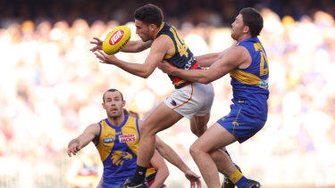 As the Crow flies: Eagle Jeremy McGovern attempts to take down Lachlan Murphy.