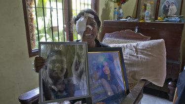 Anusha Kumari holds portraits of her daughter Sajini Venura Dulakshi and son Vimukthi Tharidu Appuhami, both victims of Easter Sunday's bomb blast in Negombo. Her husband was also killed in the attack.