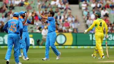 Alex Carey of Australia  returns to the pavilion after beIng caught by Virat Kholi off the bowling of Bhuvneshwar Kumar.