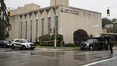 Police stand guard outside the Tree of Life Synagogue in Pittsburgh where a shooter opened fire.