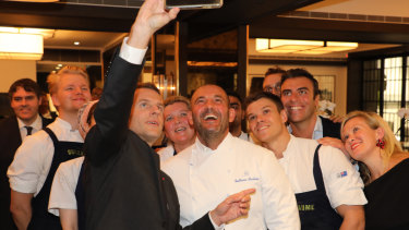 French President Emmanuel Macron taking a selfie with chef Guillaume Brahimi in May.
