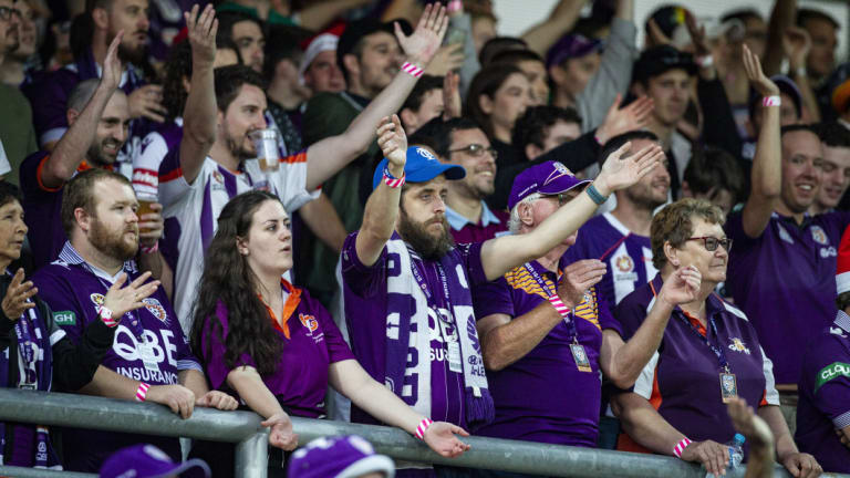 Purple patch: Perth fans show their support in the 'Shed' at nib Stadium.
